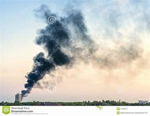 Plume Of Smoke From A Fire Above City At Sunset Stock ...