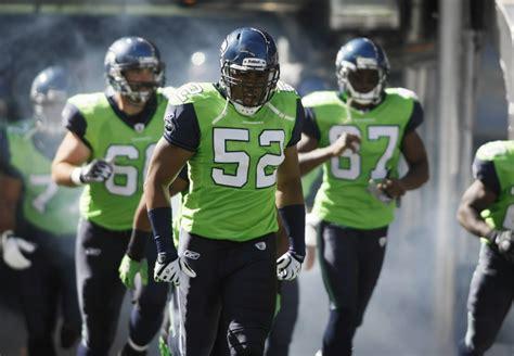 seahawks defy superstition  wear lime green