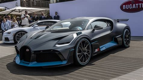 There are huge air intake at the front bugatti also took measures to create an optimized curtain of air flowing around the sides of the car, while vents behind the wheel arches reduce pressure. Bugatti Divo World Premier: When Speed is not everything!