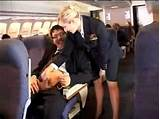 Flight attendant giving hand jobs
