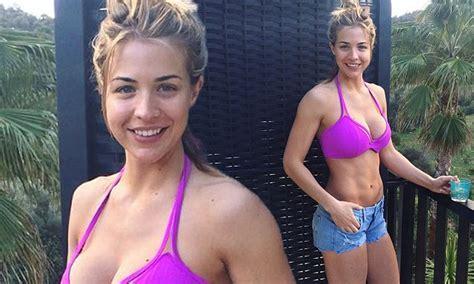 gemma atkinson shows  ample assets   pink bikini