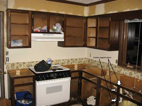 how to remove kitchen cabinets that are glued can i remove the wood between two cabinet doors the