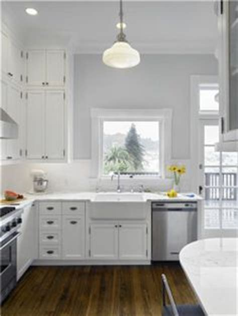 light gray kitchen walls 1000 images about white kitchen cabinets gray tile floors 6987