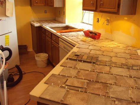 tile over laminate counter tops? What an inexpensive way