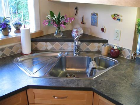 Blanco corner sink, with raised back triangle. Laminate