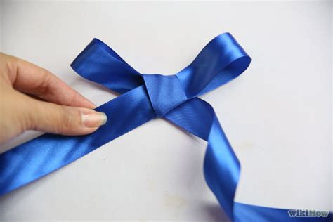 make a bow out of ribbon make a bow out of a ribbon step 11 version 2 jpg