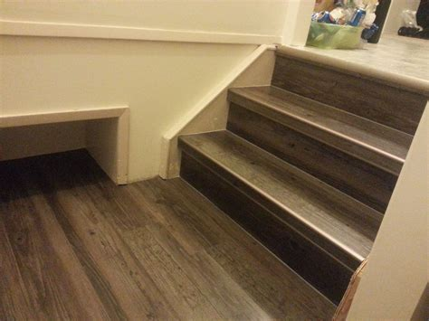vinyl flooring for stairs drop done luxury vinyl plank in eastern township with metal insert stair nosing project