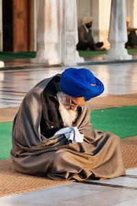 Sikh Man Praying In Golden Temple In The Early Morning ...