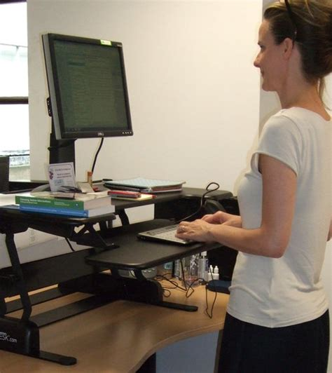benefits of sit stand desk advantages and disadvantages of a sit stand desk