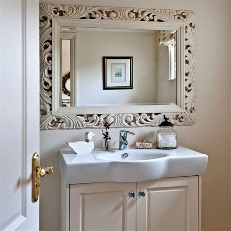 neutral bathroom  dramatic mirror country decorating