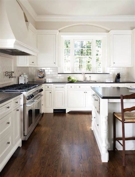 white kitchen with black countertops home interior