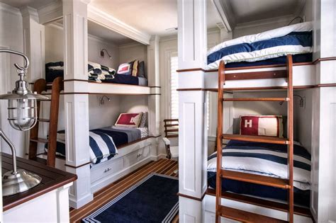 Not so with this wall of bunk beds, which was thoughtfully designed with a small window in each sleeping space. Delorme Designs: NAUTICAL BUNK BEDS