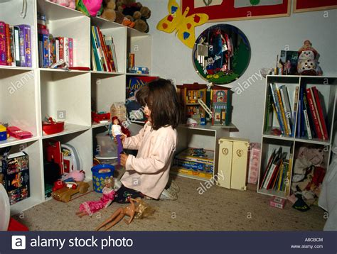 Bedroom Tidying by Child In Bedroom Tidying Room Stock Photo Royalty Free