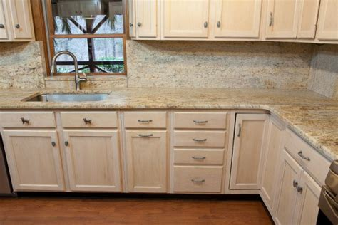 light tan kitchen cabinets dark granite countertops with light cabinets images