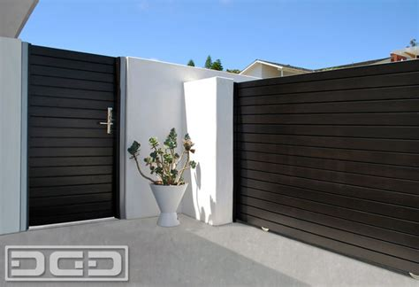 modern gates images modern wood entry gates and contemporary rolling gates by dynamic garage door custom design