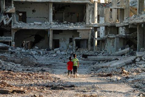 syrian syria walk street war torn buildings boys down children destroyed conflict opposition envoy slams shocking statement un jordan region