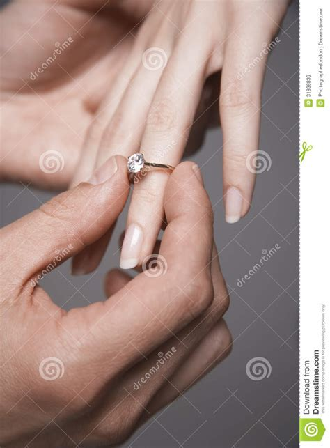 man placing engagement ring in woman s finger royalty free stock image image 31838836