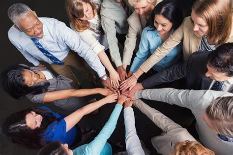 diverse business team  hands  huddle  celebrate