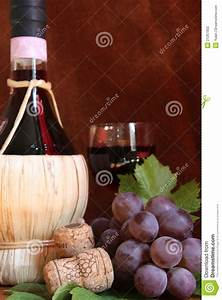 Chianti Wine Bottle With Grape And Corks Stock Image