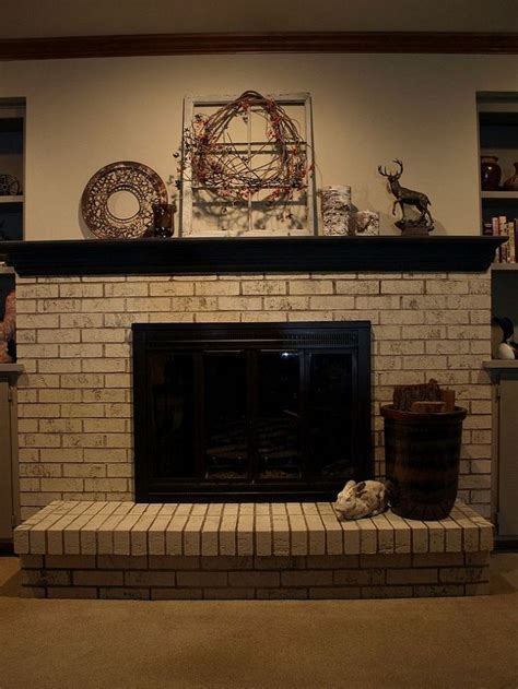 paint brick fireplace painting a brick fireplace with chalk paint 174