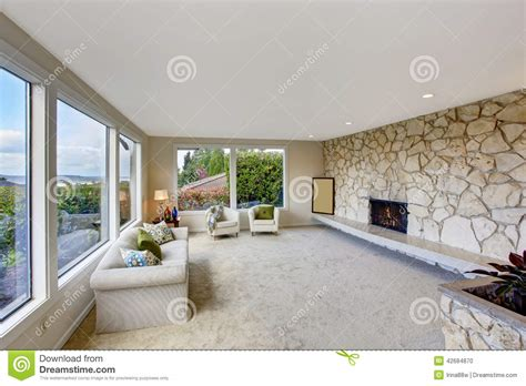 Living Room Layout With Fireplace by Bright Living Room With Rock Wall Trim And Fireplace Stock