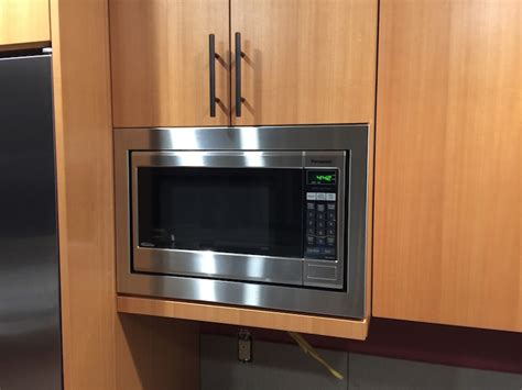 microwaves that can be mounted under cabinets is there a microwave trim kit that you can flush mount to