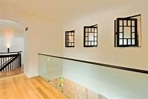 Glass interior wall and pivoting interior windows