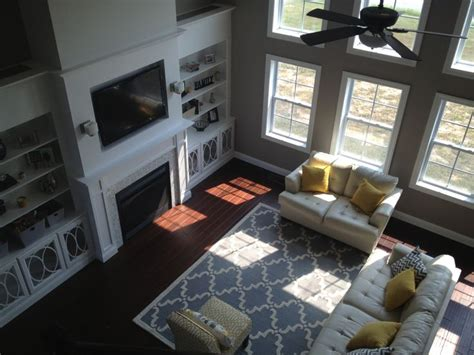 story living room yellow  gray built ins trellis