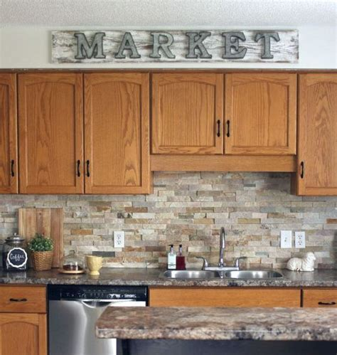 what to look for in kitchen cabinets how to make a galvanized market sign stone backsplash