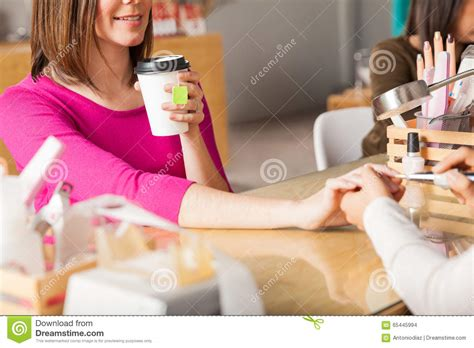 We Serve Drinks At Our Nail Salon Stock Photo