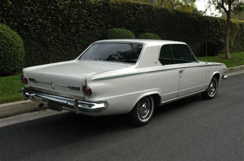 Black-plate 1964 Dodge Dart Gt