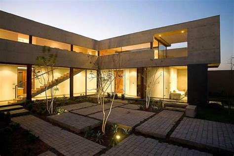 shaped plan house design   central courtyard  artfully connects indoors