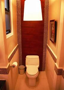 Decorating around a small toilet space in a half bath for Toilet bathroom designs small space