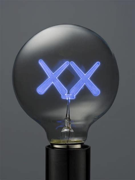 cool blue light bulbs limited edition light bulbs by kaws design milk