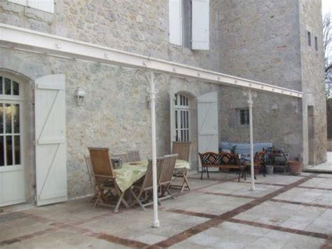 cuisine lounge conception et création de pergola à l ancienne en fer