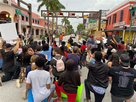 Protesters march in downtown Delray Beach | WPEC