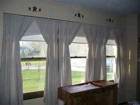 pictures of curtains on three windows curtain
