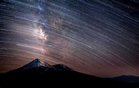 Millions Stars Trail Light Across The Sky With