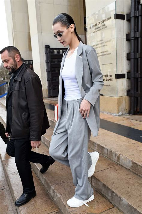 bella hadid sports a gelled hair look with a grey suit as ...
