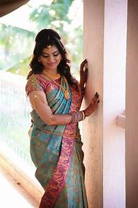 Traditional Southern Indian bride wearing bridal silk saree and jewellery Reception look