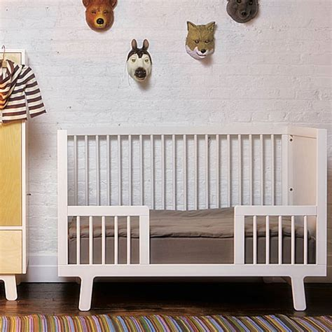 cribs that convert to toddler beds sparrow crib toddler bed conversion kit in white and