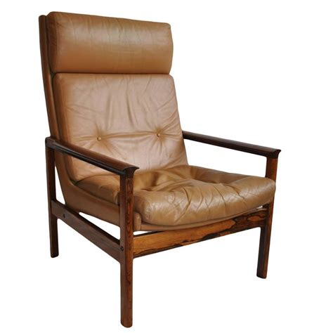 mid century leather armchair and ottoman at 1stdibs