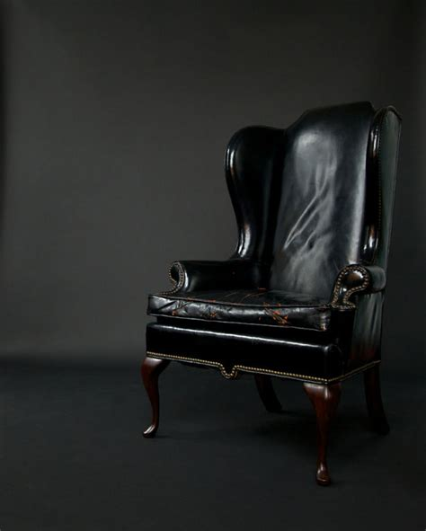 two early 1940 s wingback black leather chairs fritz