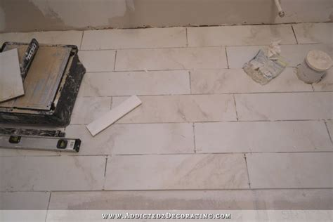 tiled bathroom floor progress plus a few tiling tips