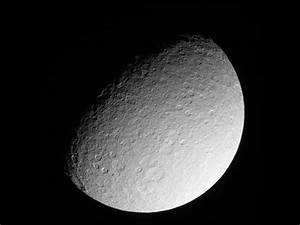Rhea: Saturn's Dirty Snowball Moon