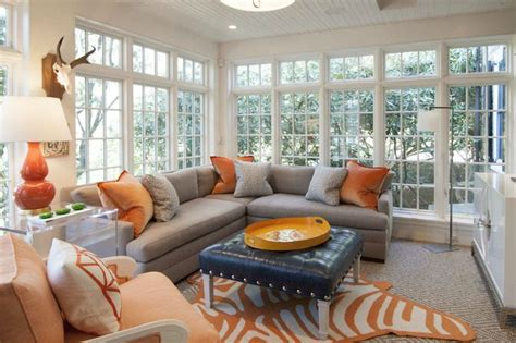 Living Room Decor With Orange Walls by Gray And Orange Living Room Features Walls Of