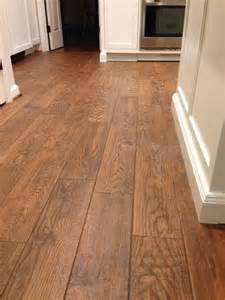 flooring marrazzi gunstock oak porcelain tile home depot brown sanded grout which looked