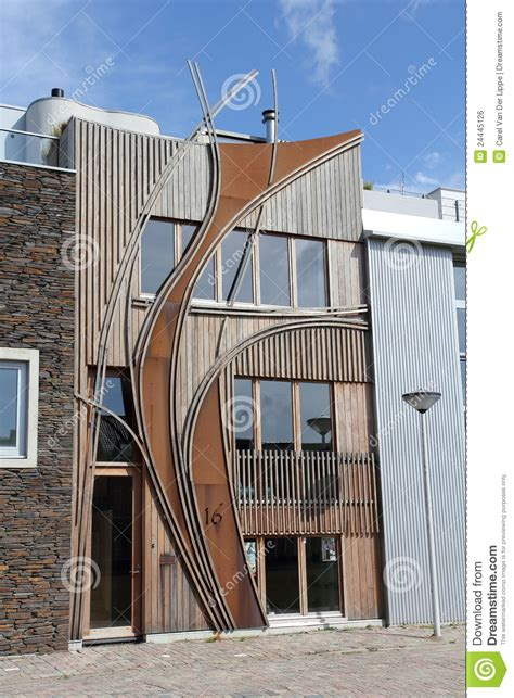 modern dutch home  wooden curved facade stock photo