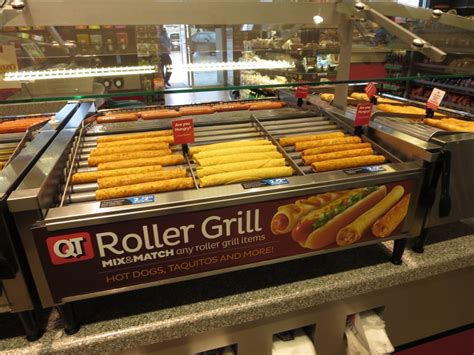 Roller grill with hot dogs, taquitos, and more. - Yelp