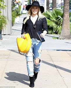 Hilary Duff brightens up her black outfit with a striking yellow handbag | Daily Mail Online